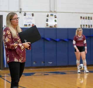 Prairie Ridge head volleyball coach Stefanie Otto studies the Cary-Grove defense Thursday, October 18, 2018 in Cary. Prairie ridge wins the match in two straight sets and clinches the Fox Valley Conference title. Her daughter, Jayden (right) is a senior. KKoontz – For Shaw Media
