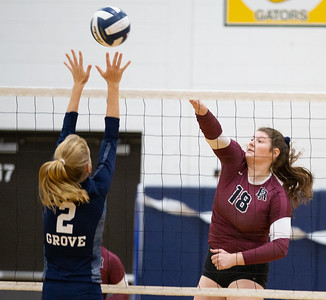 Prairie Ridge's Madeline McGuire (Right) spikes the ball over Cary-Grove's Alexis German Thursday, October 18, 2018 in Carry. Prairie ridge wins the match in two straight sets and clinches the Fox Valley Conference title.  KKoontz – For Shaw Media
