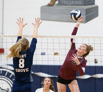 Prairie Ridge's Hannah Baudin (Right) spikes the ball over Cary-Grove's Jennifer Apitz Thursday, October 18, 2018 in Carry. Prairie ridge wins the match in two straight sets and clinches the Fox Valley Conference title.  KKoontz – For Shaw Media