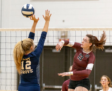 Prairie Ridge's Samantha Lockwood (Right) spikes the ball over Cary-Grove's Julia Rice Thursday, October 18, 2018 in Carry. Prairie ridge wins the match in two straight sets and clinches the Fox Valley Conference title.  KKoontz – For Shaw Media