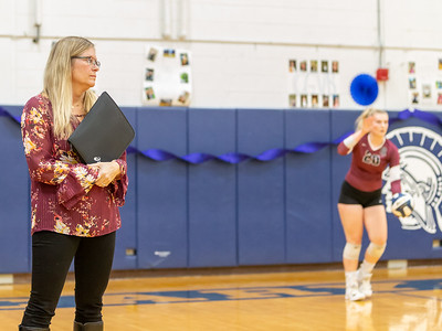 Prairie Ridge head volleyball coach studies the Cary-Grove defense Thursday, October 18, 2018 in Cary. Prairie ridge wins the match in two straight sets and clinches the Fox Valley Conference title. Her daughter, Jayden (right) is a senior. KKoontz – For Shaw Media