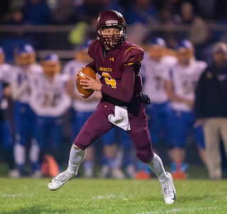 Richmond-Burton quarterback Jacob Huber drops back for a pass against Johnsburg Friday, October 19, 2018 in Richmond. Richmond went on to win 31-21. KKoontz – For Shaw Media