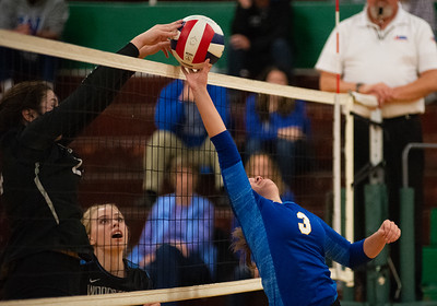 Randy Stukenberg - For Shaw Media  Woodstock's Madelyn Moan blocks Johnsburg's Adisyn Illg's attempt to hit the ball over the net during the first game of the semifinal match of the Class 3A Boylan Regional on Tuesday, Oct. 23, 2018. Woodstock won the match 25-18, 28-26.