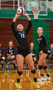 Randy Stukenberg - For Shaw Media  Woodstock's Sophia Wicker sets the ball during the first game of the semifinal match of the Class 3A Boylan Regional on Tuesday, Oct. 23, 2018. Woodstock won the match 25-18, 28-26.