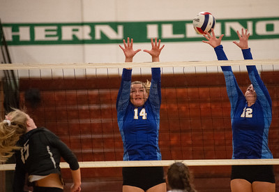 Randy Stukenberg - For Shaw Media  Johnsburg's Megan Madsen, 14, and Morgan Madsen, 12, try to block a spike by Woodstock's Lauryn Hahn during the first game of the semifinal match of the Class 3A Boylan Regional on Tuesday, Oct. 23, 2018. Woodstock won the match 25-18, 28-26.