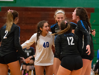 Randy Stukenberg - For Shaw Media  Woodstock team members celebrate tying the score at 25 during the second game of the semifinal match of the Class 3A Boylan Regional on Tuesday, Oct. 23, 2018. Woodstock won the match 25-18, 28-26.