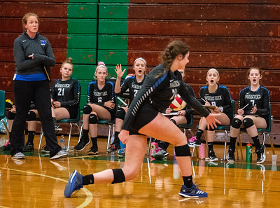 Randy Stukenberg - For Shaw Media  Woodstock team members and coach react after a ball slips past Madelyn Moan during the second game of the semifinal match of the Class 3A Boylan Regional on Tuesday, Oct. 23, 2018. Woodstock won the match 25-18, 28-26.