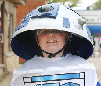 Candace H. Johnson-For Shaw Media Otto Glader, 9, of Antioch peaks out from his R2-D2 costume as he walks along Lake Street to get candy from businesses during Treat the Streets in downtown Antioch. Otto was at the event with his mother, Jenna.(10/20/18)
