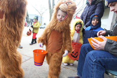 Candace H. Johnson-For Shaw Media Claire Schellinger, 4, of Pleasant Prairie, Wis., dressed as an orangutan, walks along Lake Street getting candy from businesses during Treat the Streets in downtown Antioch. (10/20/18)