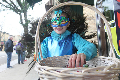 Candace H. Johnson-For Shaw Media Emma Lolmaugh, 9, of Trevor, Wis., dressed as a peacock, gets ready to hand out candy for The Barker Shoppe during Treat the Streets in downtown Antioch. Emma was handing out candy with Kaylee Kennedy,10, of Antioch.(10/20/18)