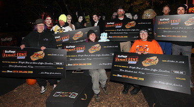 Candace H. Johnson-For Shaw Media Participants Lynn Johansen, of Franklin Park, Nathan Tamayo, of Park Ridge, Allison Jornlin, of Milwaukee, Wis., Wayne Allison, of Gurnee, Rachel West, of DeKalb, and Michael J. Finn, of Madison, Wis., hold up their checks after completing the 30 Hour Coffin Challenge for Fright Fest at Six Flags Great America in Gurnee. The six winners received $300, two 2019 Gold season passes to Great America, two Express Haunted House wrist bands, their coffin and a chance to be in the Uprising Parade. (10/21/18)