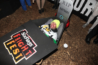 Candace H. Johnson-For Shaw Media Local funeral director and embalmer, Nathan Tamayo, of Park Ridge, lays in a coffin during the 30 Hour Coffin Challenge for Fright Fest at Six Flags Great America in Gurnee. Six winners including Nathan, received $300, two 2019 Gold season passes to Great America, two Express Haunted House wrist bands, their coffin and a chance to be in the Uprising Parade. (10/21/18)