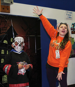Candace H. Johnson-For Shaw Media Alexander Lopez-Rios, 8, of Round Lake is announced by Maddi Desens, 21, of Round Lake for the Costume Contest for ages 7 through 9 during the Great Pumpkin Celebration at the Robert W. Rolek Community Center in Round Lake.(10/20/18)