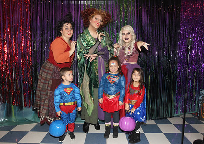Candace H. Johnson-For Shaw Media The Hocus Pocus Sanderson Sisters pose with Julian Gonzalez, 3, his sister, Mariah, and cousin, Selena, both 4, all of Waukegan during the Great Pumpkin Celebration at the Robert W. Rolek Community Center in Round Lake.The Hocus Pocus sisters were portrayed by Ashley Thomas, of Winthrop Harbor, Will Roberts and Savannah Thomas, both of Libertyville.(10/20/18)