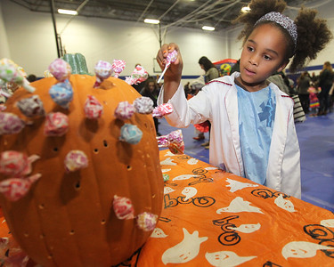 Candace H. Johnson-For Shaw Media Sydney Saylor, 6, of Zion tries her luck at the Lollipop Pull for a prize during the Great Pumpkin Celebration at the Robert W. Rolek Community Center in Round Lake.(10/20/18)
