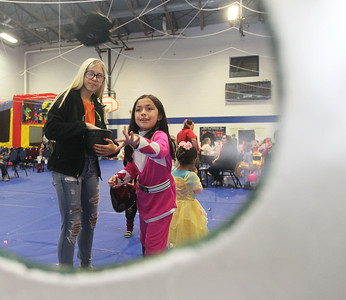Candace H. Johnson-For Shaw Media Brooke Goshinsky, 15, of Hainesville watches Isabella Martinez, 9, of Round Lake Beach play the Bats in a Tree game during the Great Pumpkin Celebration at the Robert W. Rolek Community Center in Round Lake.(10/20/18)