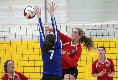 Candace H. Johnson-For Shaw Media Grant's Jazzlyn Linbo gets past the block by Lake Zurich's Riley O'Sullivan (#7) in the second set during the regional play-in game at Stevenson High School in Lincolnshire. Lake Zurich won 25-9, 25-20.
