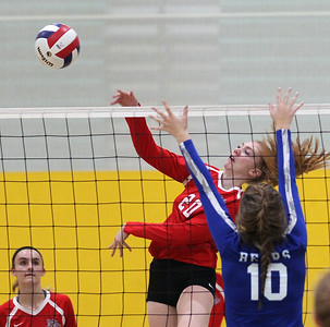 Candace H. Johnson-For Shaw Media Grant's Anelise Johnson (#20) gets past the block by Lake Zurich's Katie Keenan in the second set during the regional play-in game at Stevenson High School in Lincolnshire. Lake Zurich won 25-9, 25-20.