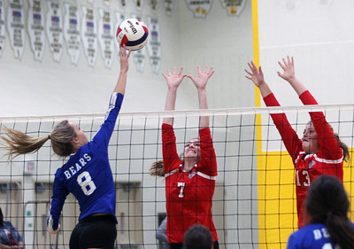 Candace H. Johnson-For Shaw Media Grant's Brooke Karpinske (#7) and Jazzlyn Linbo (#13) try to block a shot by Lake Zurich's Morgan Davis in the first set during the regional play-in game at Stevenson High School in Lincolnshire. Lake Zurich won 25-9, 25-20.
