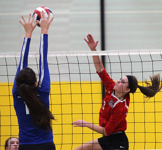 Candace H. Johnson-For Shaw Media Grant's Megan Mitchell (#3) makes an attack against Lake Zurich's Nicole Mironchik as she clears the block in the second set during the regional play-in game at Stevenson High School in Lincolnshire. Lake Zurich won 25-9, 25-20.