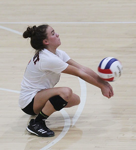 Candace H. Johnson-For Shaw Media Grant's libero Courtney Levy gets down low to pass the ball against Lake Zurich in the second set during the regional play-in game at Stevenson High School in Lincolnshire. Lake Zurich won 25-9, 25-20.