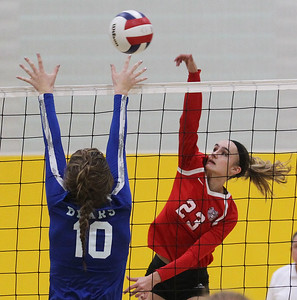 Candace H. Johnson-For Shaw Media Grant's Laine Evans (#23) gets the ball past Lake Zurich's Katie Keenan in the first set during the regional play-in game at Stevenson High School in Lincolnshire. Lake Zurich won 25-9, 25-20.