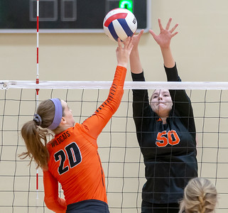 Crystal Lake Central's Camryn Hausler goes up for the block against Libertyville's Kellie Hopper Thursday, October 25, 2018 at the Class 4A Regional Final game in Libertyville. Crystal Lake Central wins their fourth straight regional championship in two-straight sets. KKoontz – For Shaw Media