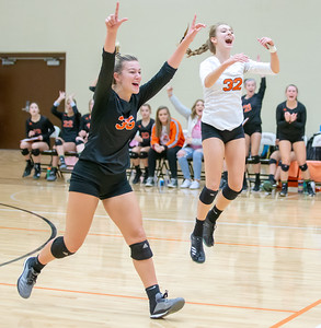 Crystal Lake Central's Madelyn Blake (left) and Karina Simatos celebrate a first set victory Thursday, October 25, 2018 in Libertyville during the Class 4A regional finals match. Crystal Lake Central wins their fourth straight regional championship in two-straight sets. KKoontz – For Shaw Media
