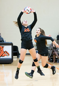Crystal Lake Central's Grace Levin sets the ball against Libertyville Thursday, October 25, 2018 Libertyville during the Class 4A regional finals match. Crystal Lake Central wins their fourth straight regional championship in two-straight sets. KKoontz – For Shaw Media