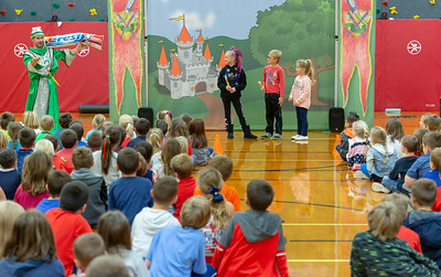 Rylinn Tonyan (third grade), Evan Carlson (first grade), and Paitynn Sitter (kindergarten) volunteer for a school play at Richmond Grade school Friday, October 26, 2018 in Richmond. The play, hoste by Delta Dental promotes proper oral hygiene and eating habits. KKoontz – For Shaw Media