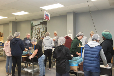 Candace H. Johnson-For Shaw Media A group of volunteers pack MannaPacks with a rice formula to be shipped to Haiti during a packing session at Feed My Starving Children in Libertyville. (10/29/18)
