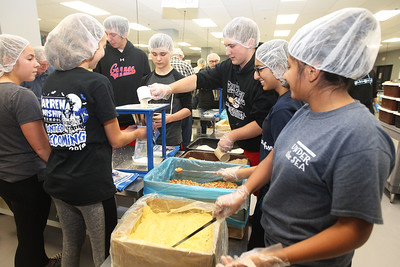 Candace H. Johnson-For Shaw Media Students from Warren Township High School Student Council O'Plaine campus fill up MannaPacks with a  nutritionally balanced meal during a packing session at Feed My Starving Children in Libertyville. (10/29/18)