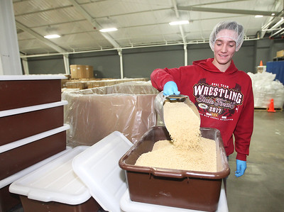 Candace H. Johnson-For Shaw Media Joe Hutson, 16, of Wauconda puts ground soy into bins for volunteers to put into MannaPacks during a packing session at Feed My Starving Children in Libertyville. (10/29/18)