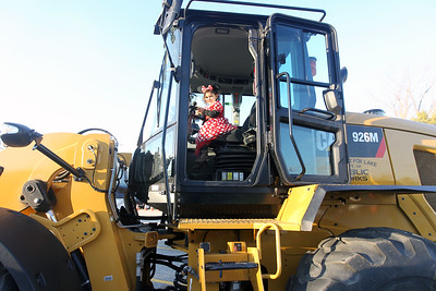 Candace H. Johnson-For Shaw Media Charlotte Sonnefeldt, 2, of Spring Grove, dressed as Minnie Mouse, sits in a Village of Fox Lake Dept. of Public Works pay loader during Halloween Howl at the Fox Lake Police Department on Route 59 in Fox Lake. (10/29/18)