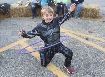 Candace H. Johnson-For Shaw Media Tyler Hughes, 9, of McHenry competes in a hula hoop contest during Halloween Howl at the Fox Lake Police Department on Route 59 in Fox Lake. (10/29/18)
