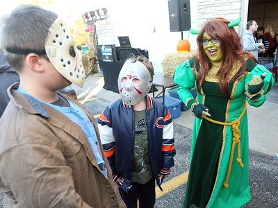 Candace H. Johnson-For Shaw Media Nathan Kringiel, 10, and Zdzislaw Macniak, 9, both of Fox Lake, dressed as Jason Voorhees, talk with Beth Cano, of Antioch, dressed as Princess Fiona during Halloween Howl at the Fox Lake Police Department on Route 59 in Fox Lake. (10/29/18)