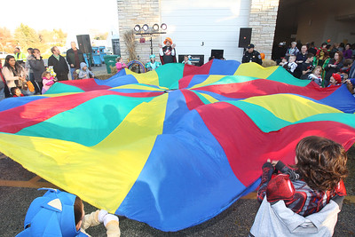 Candace H. Johnson-For Shaw Media DJ Bob with Soundwave Entertainment (center) gets a group of children to play with a giant parachute during Halloween Howl at the Fox Lake Police Department on Route 59 in Fox Lake. (10/29/18)