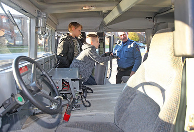 Candace H. Johnson-For Shaw Media Nathan Guzzo,12, and Ethan Berk, 11, both of Fox Lake talk to Community Service Officer William Fedderly and ask questions about the Humvee they are sitting in during Halloween Howl at the Fox Lake Police Department on Route 59 in Fox Lake. (10/29/18)