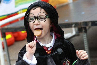 Candace H. Johnson-For Shaw Media Scott Bianchi, 7, of Wauconda eats a lollipop dressed in a Harry Potter costume during Trick or Treat Main Street in Wauconda. Scott was at the event with his parents, Chuck and Kellie.(10/28/18)