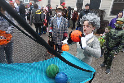 Candace H. Johnson-For Shaw Media Emily Williams watches her friend, Rachel Mooney, both 10, of Wauconda, play a basketball game as they are dressed as an old man and an old lady during Trick or Treat Main Street in Wauconda. (10/28/18)