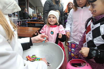 Candace H. Johnson-For Shaw Media Sadie Baum, 4, of Island Lake gets some candy from Amanda Rothgeb, of Wauconda with Honey Hill Coffee during Trick or Treat Main Street in Wauconda. (10/28/18)