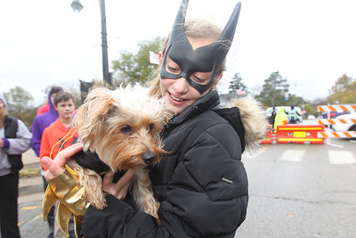 Candace H. Johnson-For Shaw Media Alexandra Goldenstein, 11, of Hawthorn Woods holds her dog, Coco, before the yorkie poo competes in the pet costume contest during Trick or Treat Main Street in Wauconda. (10/28/18)