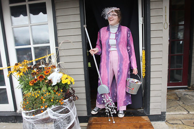 Candace H. Johnson-For Shaw Media Jessica Schacht, of Wauconda, with Middleton's on Main, portrays a witch as she waits to give out candy to children during Trick or Treat Main Street in Wauconda. (10/28/18)