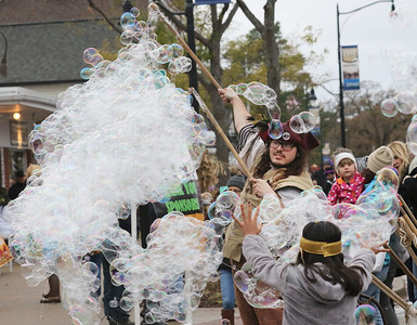 "Candace H. Johnson-For Shaw Media Nick Stahl, of Schaumburg, ""Nick the Bubble Guy,"" creates large bubbles to entertain the crowd during Trick or Treat Main Street in Wauconda. (10/28/18)"