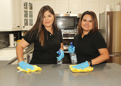 Candace H. Johnson-For Shaw Media Melissa Tosta and and Fabiola Llanes, owners of the Genesis Cleaning Experts, at Fabiola's home in Gurnee. Both volunteer for Cleaning For A Reason, a network of house cleaning services that provide free house cleaning for women undergoing treatment for any type of cancer. (10/1/19)