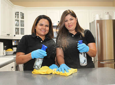 Candace H. Johnson-For Shaw Media Fabiola Llanes and Melissa Tosta, owners of the Genesis Cleaning Experts, at Fabiola's home in Gurnee. Both volunteer for Cleaning For A Reason, a network of house cleaning services that provide free house cleaning for women undergoing treatment for any type of cancer.  (10/1/19)