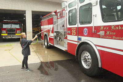 Candace H. Johnson-For Shaw Media Stanton's Amber Martin, 12, of Spring Grove washes down fire engine 25 at the Fox Lake Fire Protection District Station #2 during Fox Lake Grade School District 114's 5th Annual Day of Service. (9/27/19)
