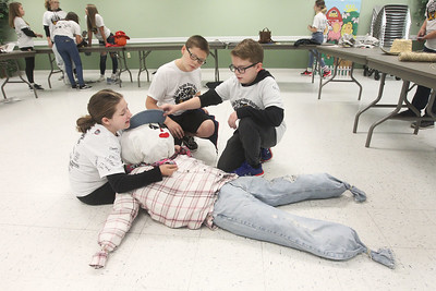 Candace H. Johnson-For Shaw Media Stanton's Kylie Shoop, Nathan Sosnowski, both of Fox Lake, and Dylan Burke, of Spring Grove, all 12, work together to build a scarecrow at the Grant Township community room for the upcoming Grant Township &  Village of Fox Lake Fall Festival during Fox Lake Grade School District 114's 5th Annual Day of Service. (9/27/19)