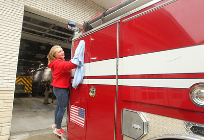Candace H. Johnson-For Shaw Media Stanton's Kelsey Frand, 12, of Fox Lake wipes down a fire engine after it was washed at the Fox Lake Fire Protection District Station #2 during Fox Lake Grade School District 114's 5th Annual Day of Service. (9/27/19)