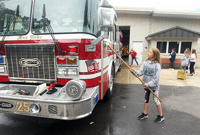 Candace H. Johnson-For Shaw Media Stanton's Amelia Szopinski, 12, of Fox Lake washes down a fire engine at the Fox Lake Fire Protection District Station #2 during the Fox Lake Grade School District 114's 5th Annual Day of Service. (9/27/19)